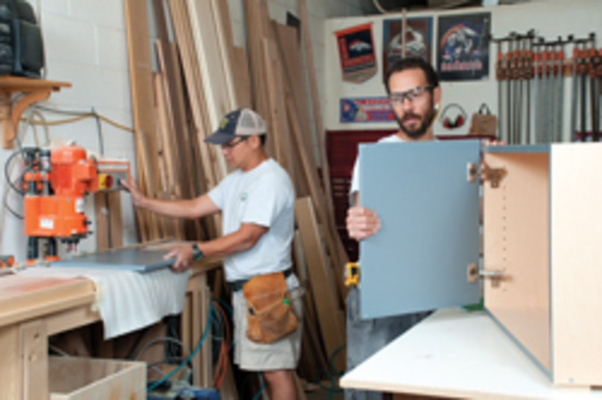 Pat Wagner and Scott Kelley, assembling cabinets.