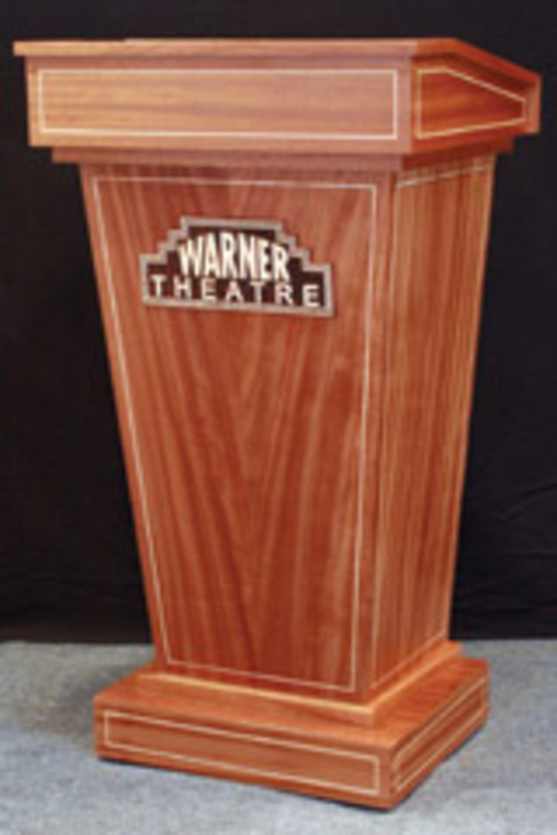 Daniel Gugnoni designed and built this podium, which reflects the Art Deco-style architectural interior of the newly renovated Warner Theatre in Torrington, Conn. It is made of African ribbon-cut mahogany with tiger maple inlays.