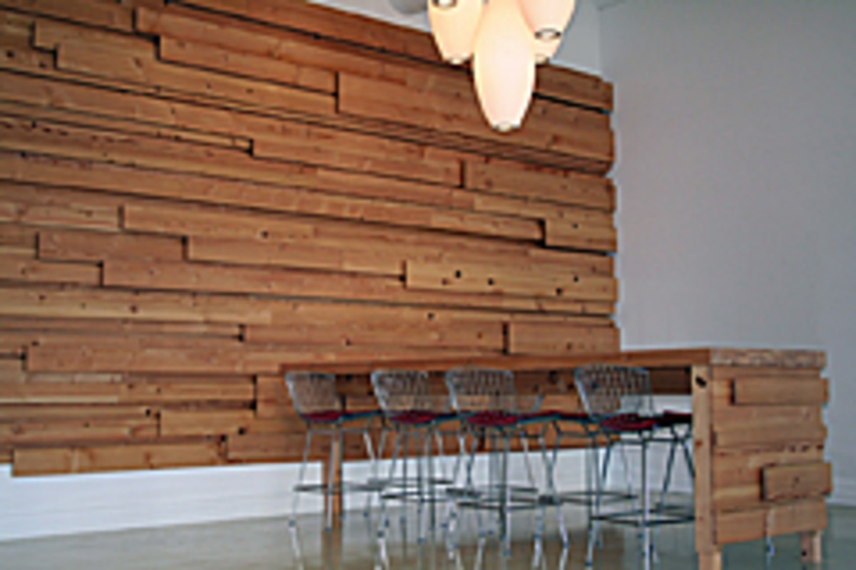 The wall installation and conference table were made for Vocon Architecture's office in Cleveland. It is made of Douglas-fir reclaimed from their building during a renovation./Photo courtesy of Jerry Mann.