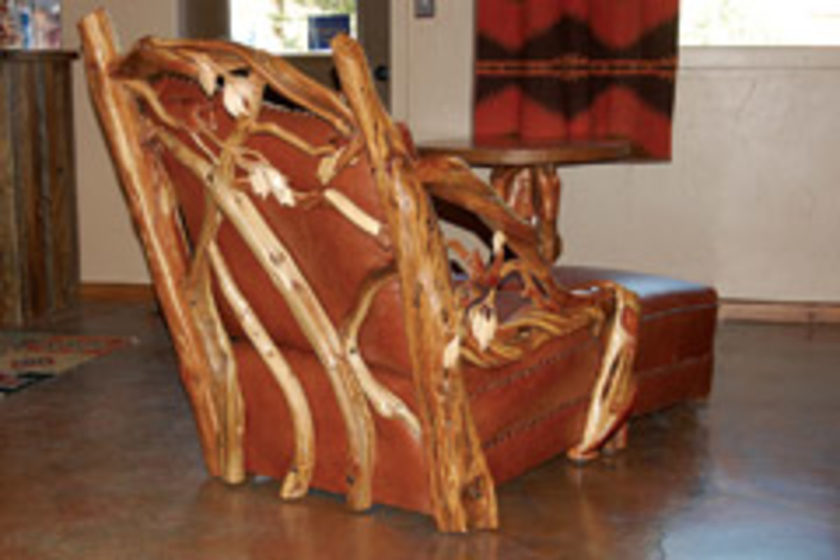 Thw owner of Santos Furniture in Cody, Wyo., used juniper and hand-laced leather trim. Kevin Showell carved the birds in flight and the leaves.