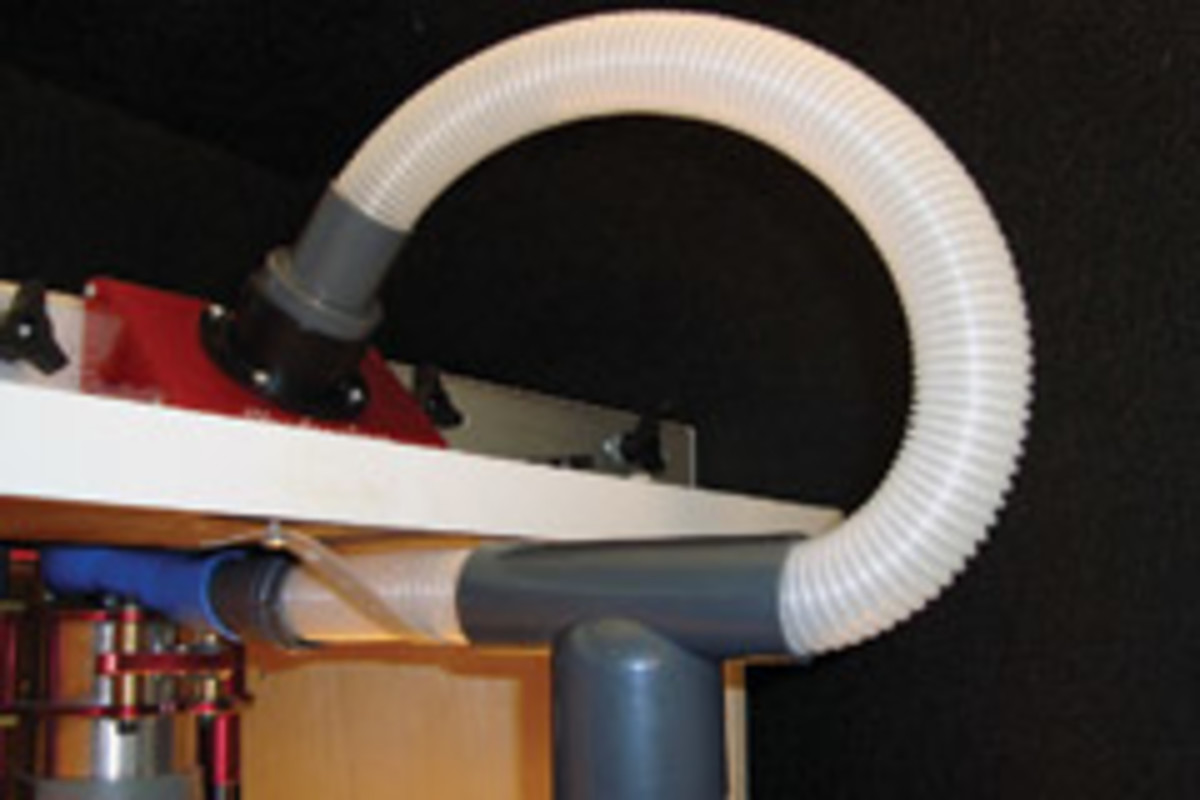 The Dust Router from Keen Products collects dust from the top and bottom of a router table.