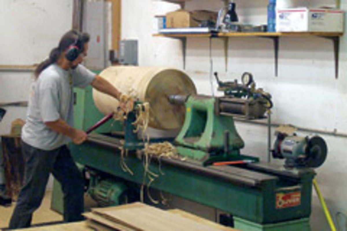 "Tom Calhoun of Makawao, Hawaii, roughs out a 20"" Norfolk pine log on an Oliver 2258S lathe built in 1964 that he bought on eBay."