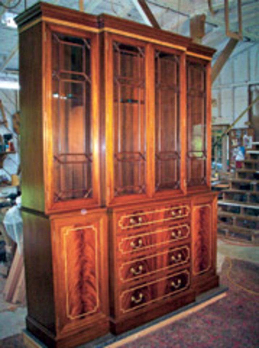 DeGruy built this gorgeous breakfast gun cabinet out of crotch mahogany.