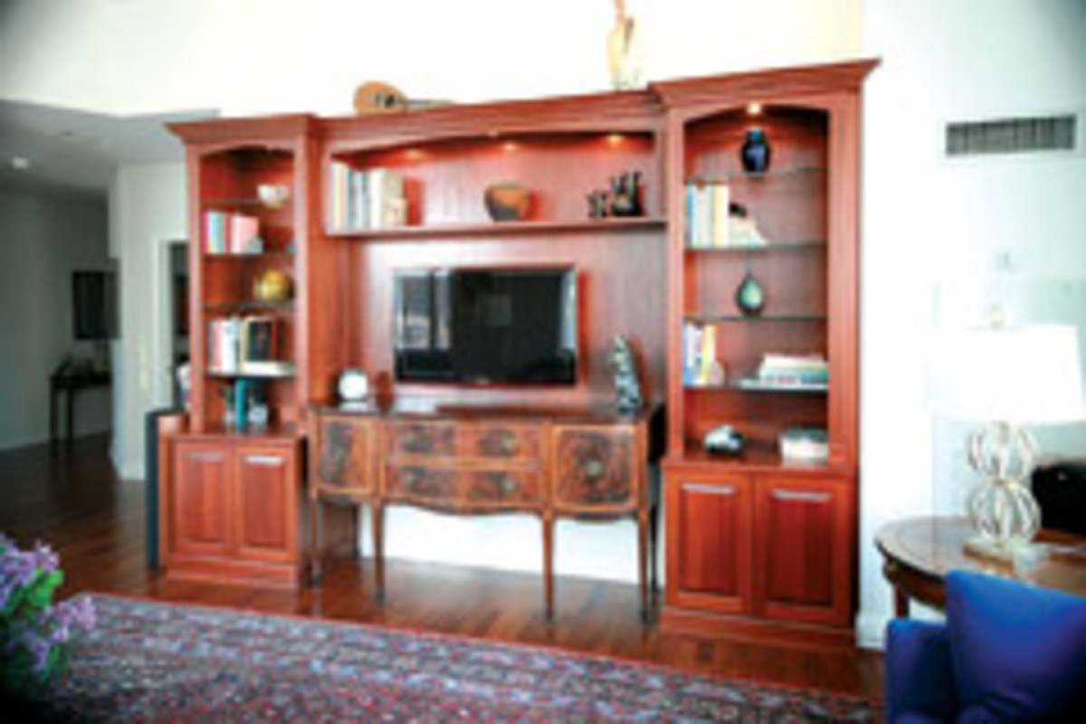 This mahogany cabinetry unit is built around a family heirloom cabinet featured in the center, behind the TV.