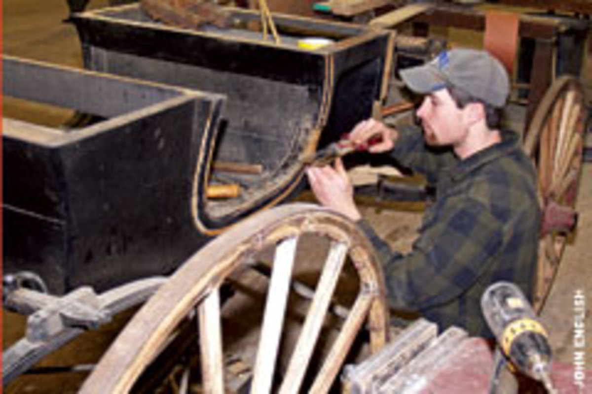 Craftsman Andrew Fridley splits his time between the wood and leather/upholstery shops.