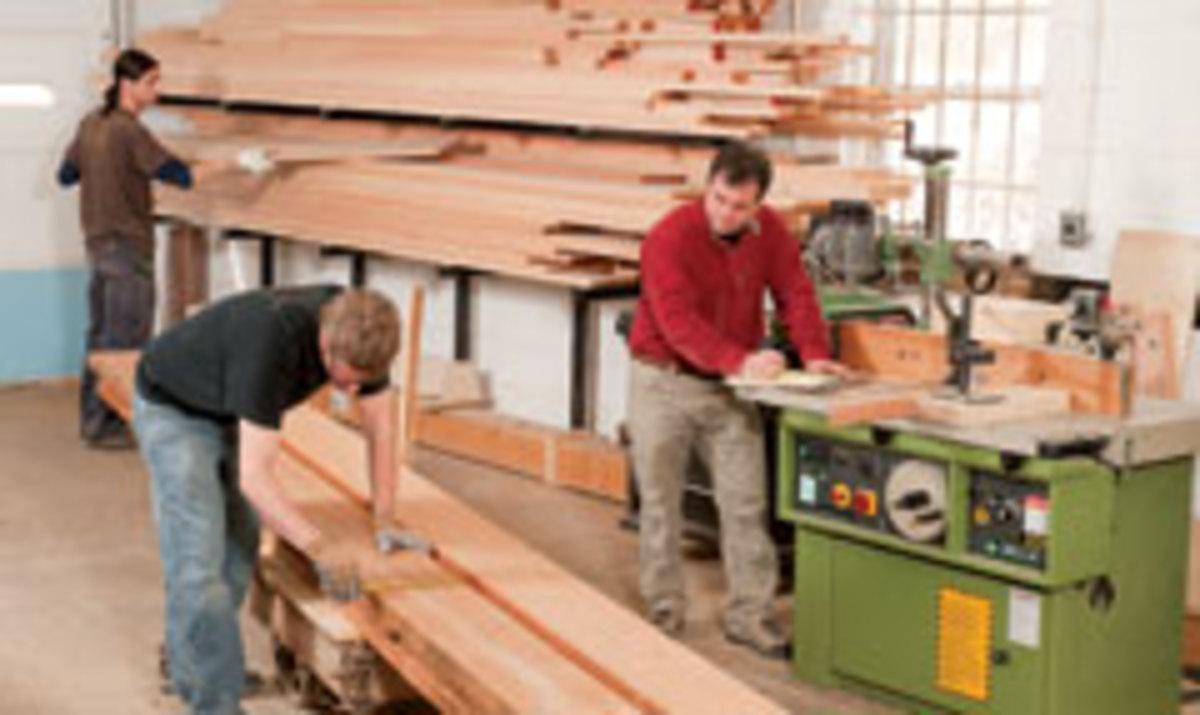 Shop manager Lou Gargiulo (left), cabinetmaker Matt Morrissey (center) and Weis fill a materials list for an upcoming project.