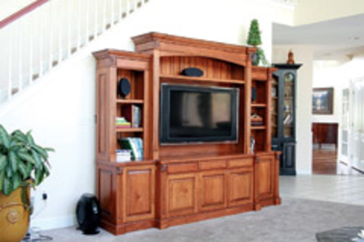 This traditional entertainment center was designed to fit the specifications of the large-screen TV. Made of cherry, it features a distressed glazed finish.