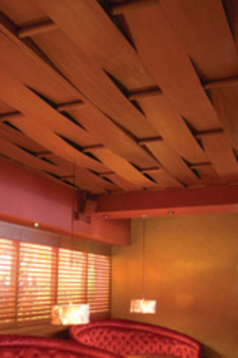 This wavy ceiling paneling illustrates the modern preferences of Doyle's clients.
