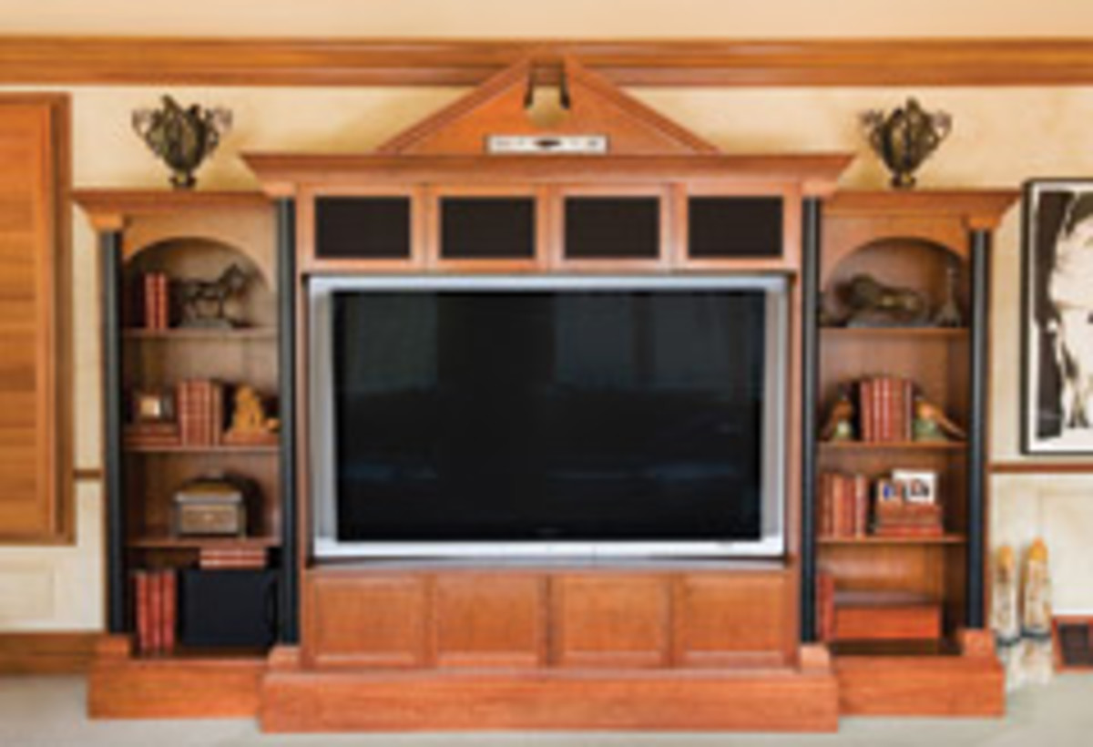 This cherry entertainment center, featuring unique black columns, is a great example of a built-to-order piece, another specialty Doyle offers.