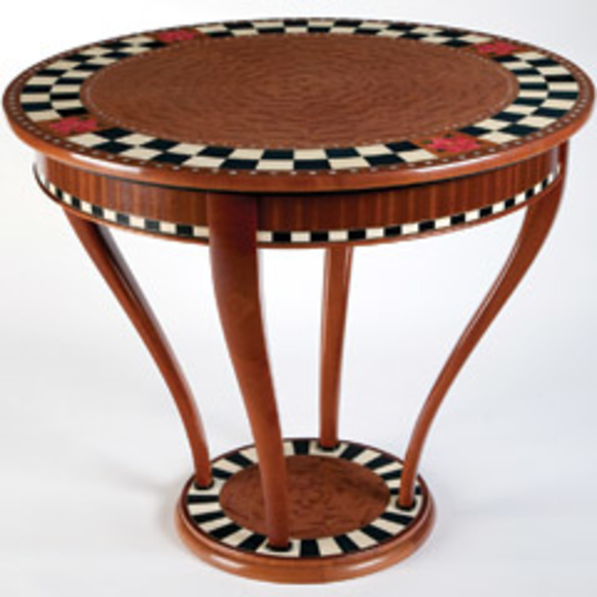 This display table made of quilted makore, mahogany, sapele and holly by Tom Christenson of Bakersfield, Calif., won a veneering/marquetry award at this year's Design in Wood competition held by the San Diego Fine Woodworkers Association.