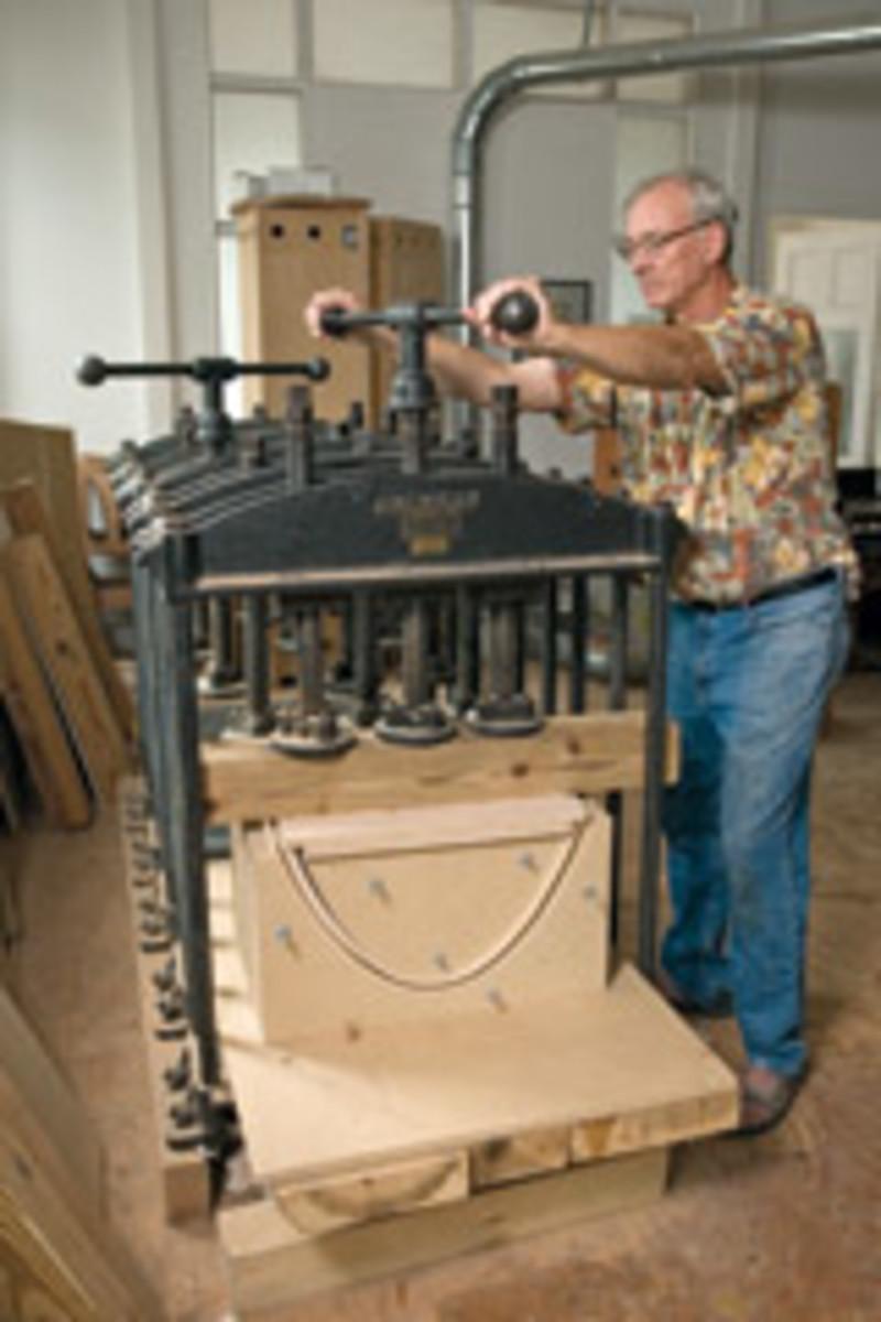Silas Kopf, legendary master of marquetry, sets up a veneer press at his Easthampton, Mass., shop.