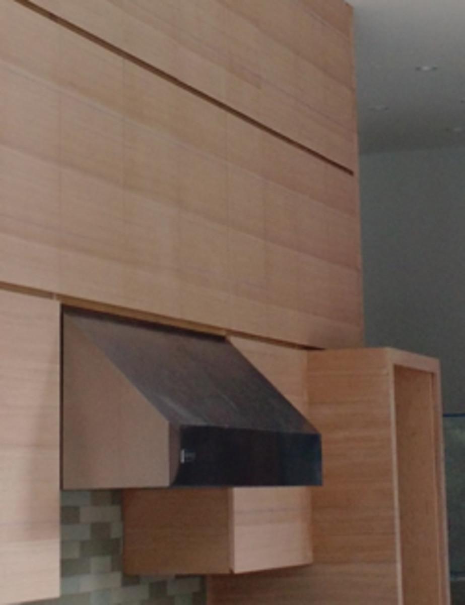 A kitchen featuring Artisan Thick rift-sawn white oak veneer.