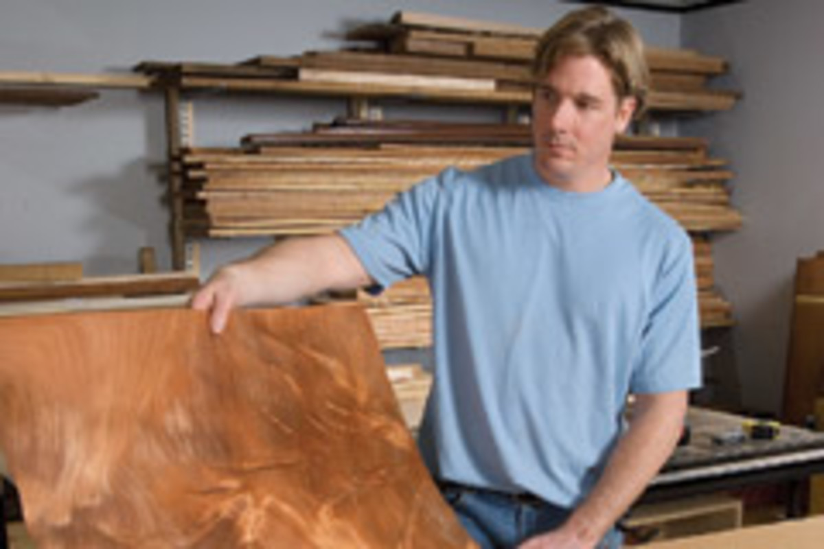 Thomas McDonald of Canton, Mass., owner of Thomas McDonald Fine Furniture checks out pieces from a wild flitch of veneer.