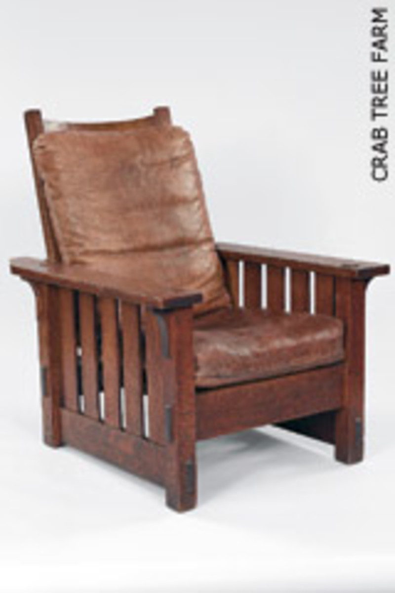 """""""Apostles of Beauty"""" Arts and Crafts from Britain to Chicago"""" featurs nearly 190 pieces, including this 1901 oak and leather armchair by Gustav Stickley."""