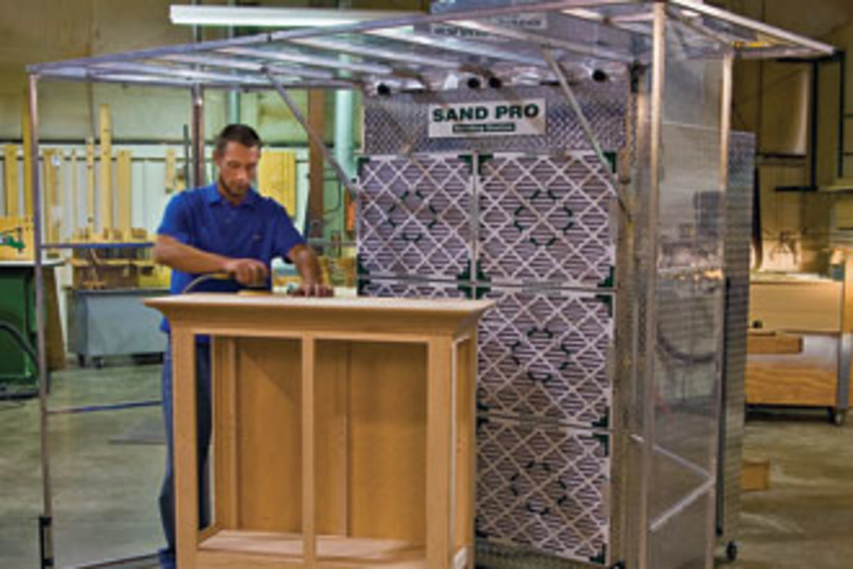 The Sand Pro sanding booth, model SB108, features hinged vinyl sides and top panels to construct the best perimeter for your workpiece, up to 9' wide.