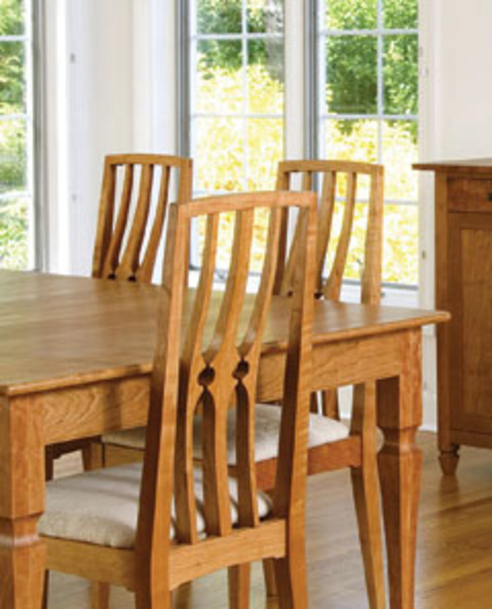 Pierced back dining set with chairs illustrates how Landis accentuates one architectural element while making sure the remaining parts of the piece are simple.