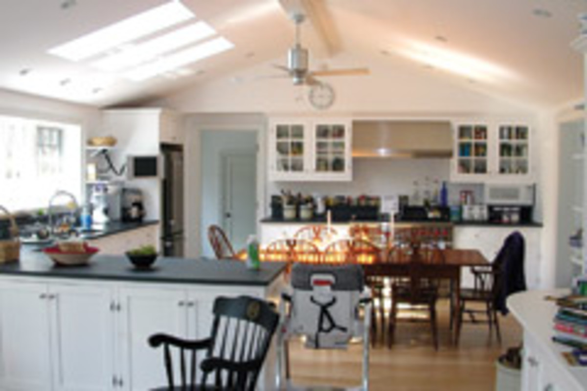 Today's kitchens are often a gathering place for meals and other family activities, as shown in this example produced by Yankee Remodelers of New London, Conn.