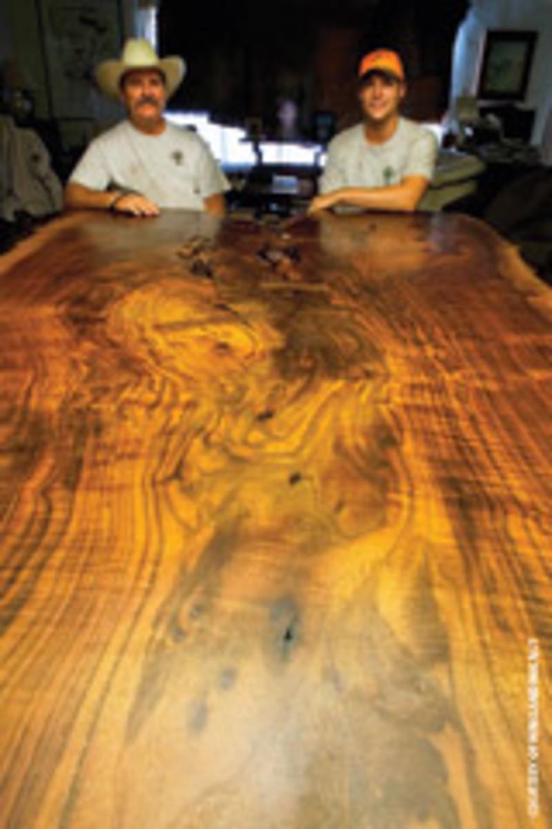 Scott and Trevor Wineland stand behind a massive slab of claro walnut.