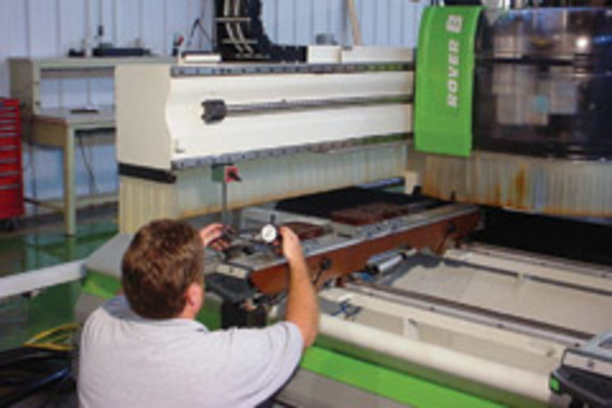 Biesse America head technician Randy Stacy works on refurbishing an edgebander as part of the Beisse Exchange plan.