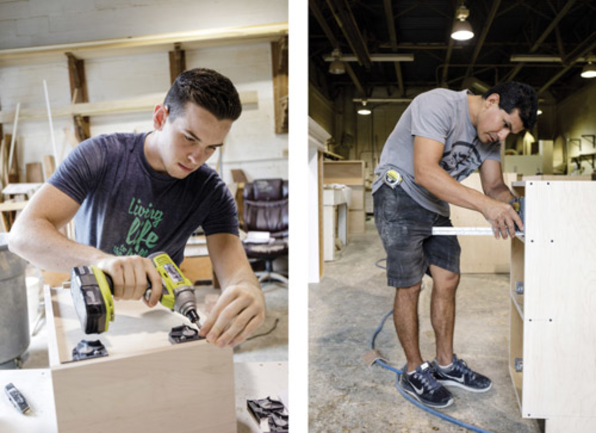 Nate Lardieri (left) and Daniel Ramirez installing hardware.