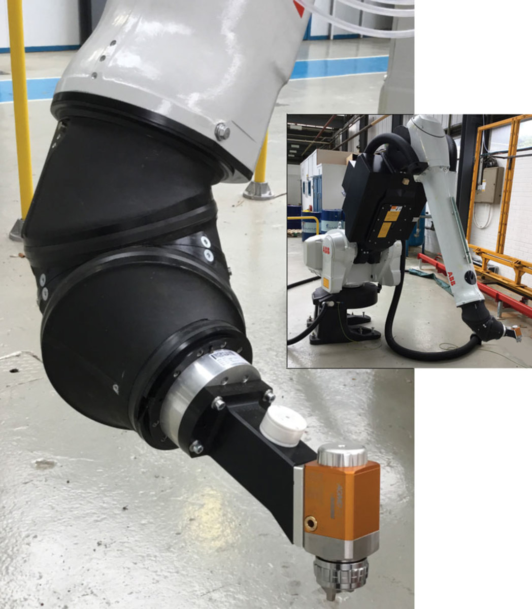 The DeVilbiss AGMD Pro spray gun, mounted to a robot, at Mitras Automotive