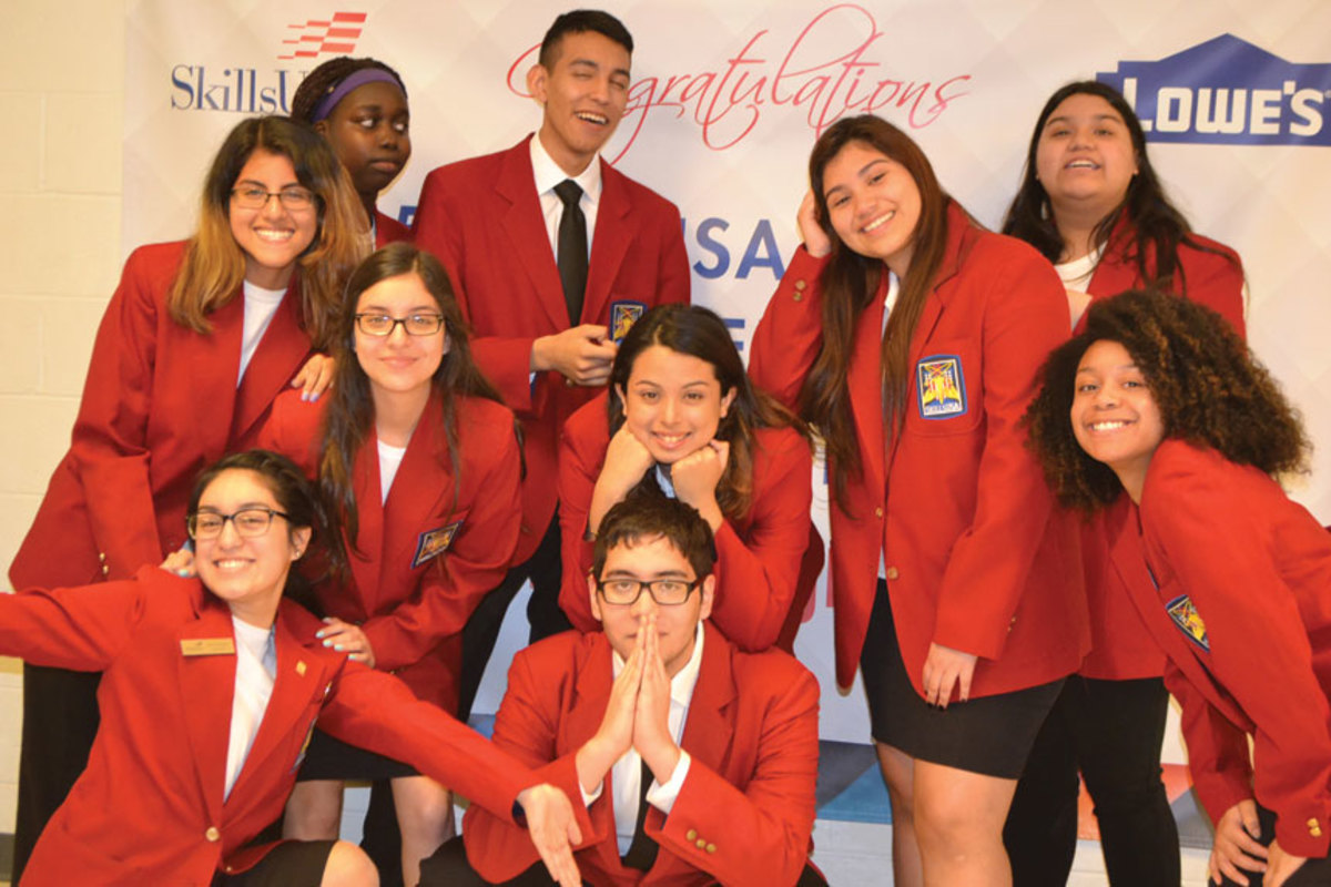 Students from Massachusett's Greater Lowell Technical High School celebrate their achievement.