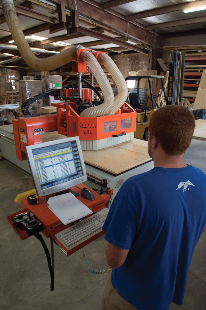 worker-with-cnc-machine