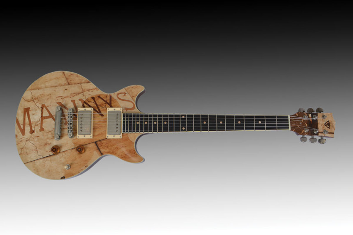 "The ""New Work by Faculty"" exhibit includes this guitar by Jim Macdonald."