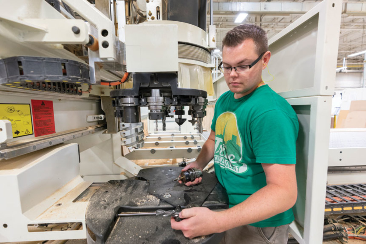 Ryan Gosselin changes heads on the SCM Routech 5-axis CNC.