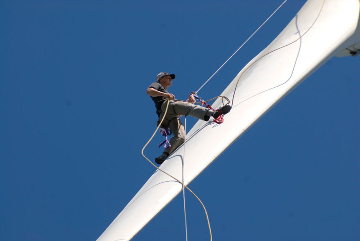 Mark Richey inspecting the wind turbine.