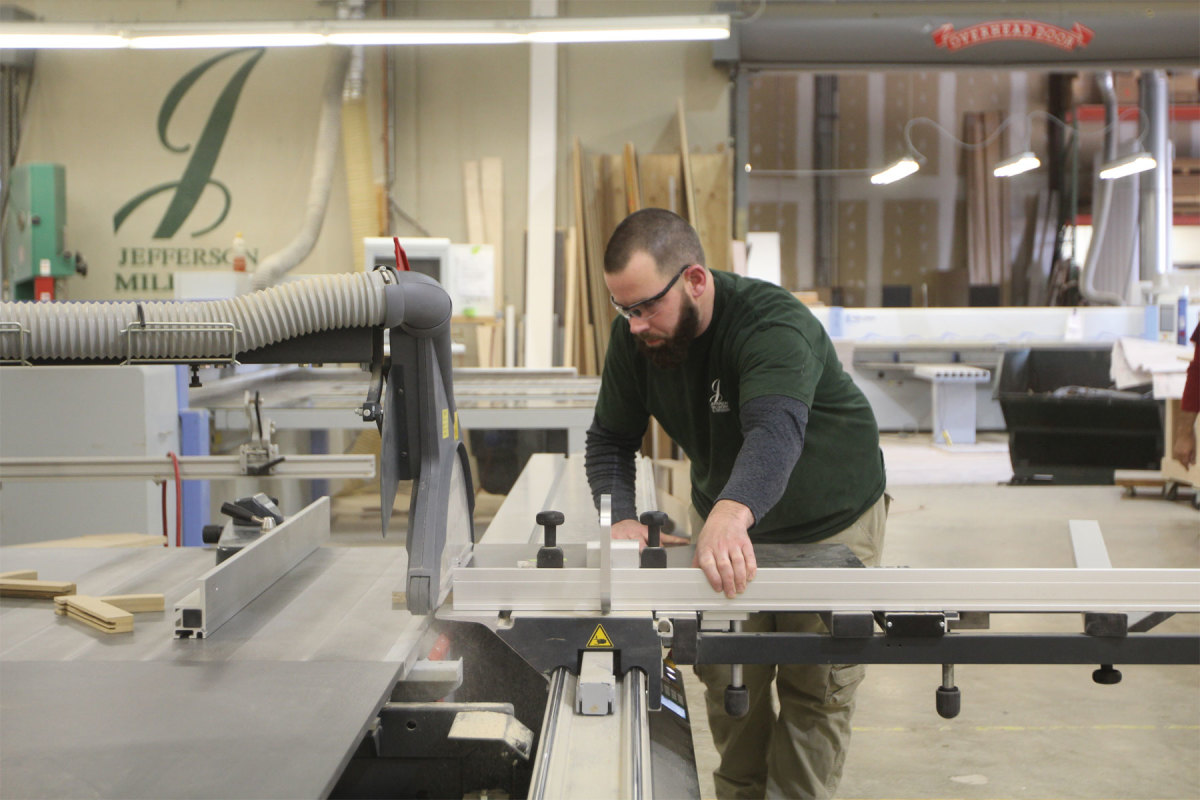 Chad McCabe tests his skills on the sliding table saw at Jefferson Millwork