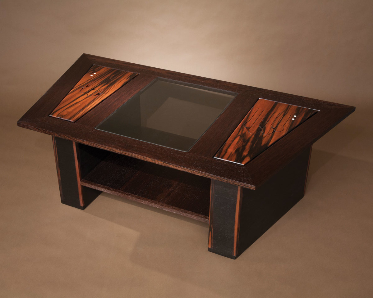 Rosewood, ebony and wenge trapezoid table.