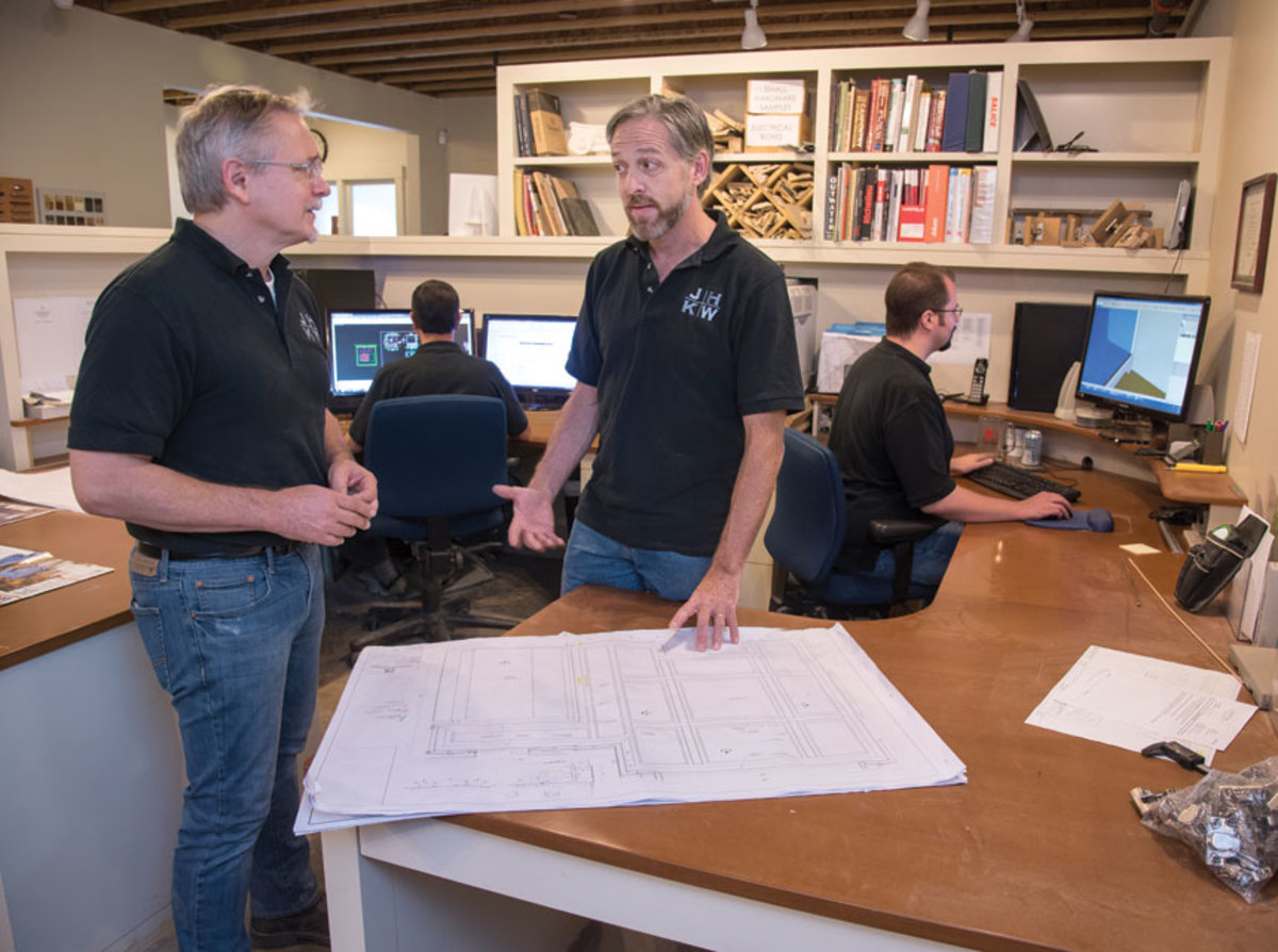 John Wassink, left, confers with project manager Peter Dianni.