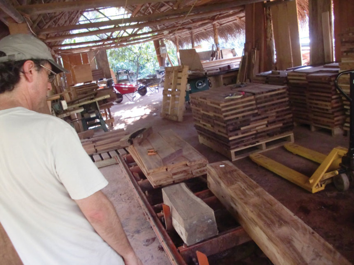 Ron Samuels inspects rosewood milled in Central America.