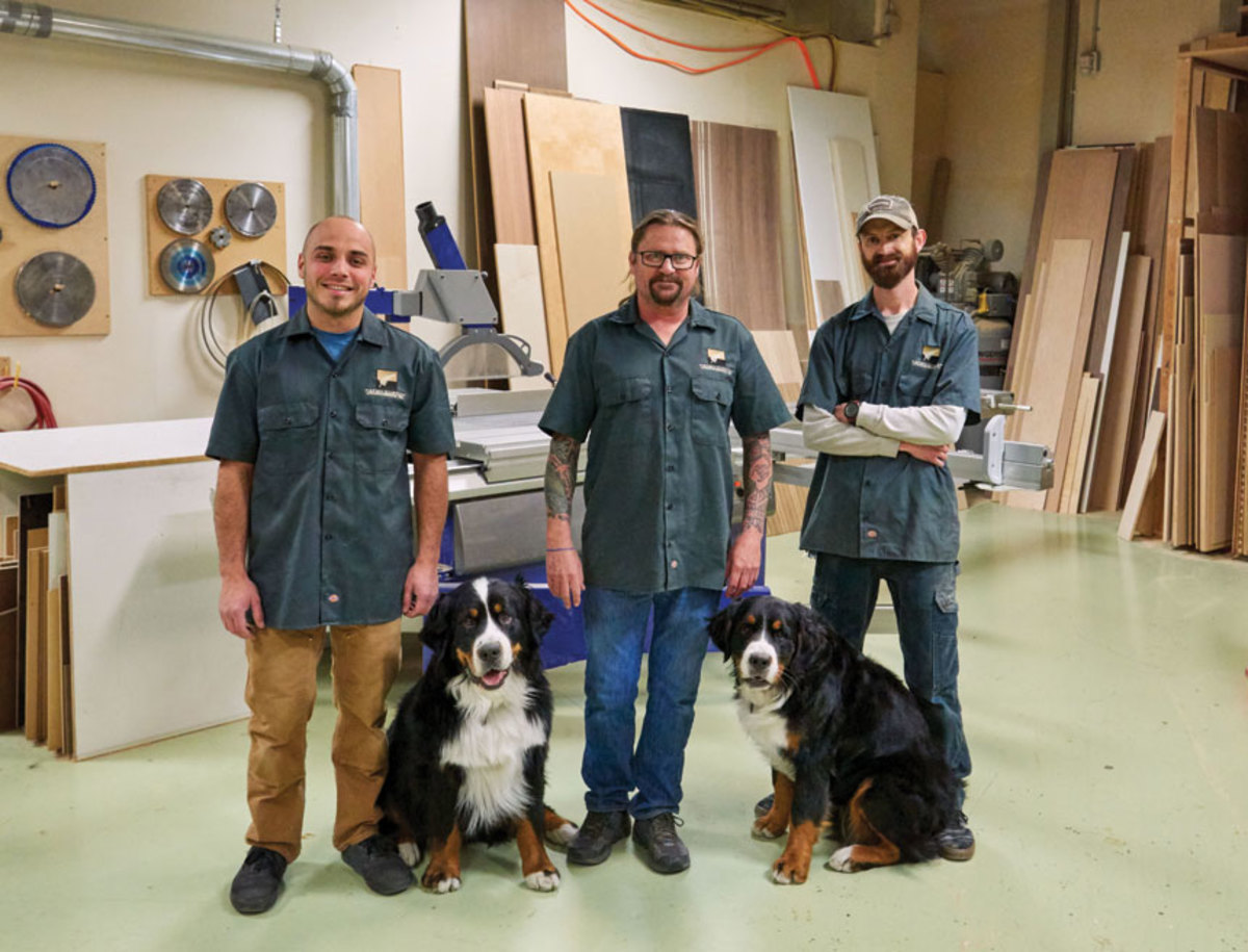 The team at Aspen Custom Woodworking also includes Luke Newlin (right) and two Bernese mountain dogs, Manu and Nui.