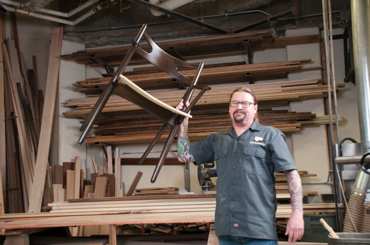 Anderson with one of the shop's popular chair designs.