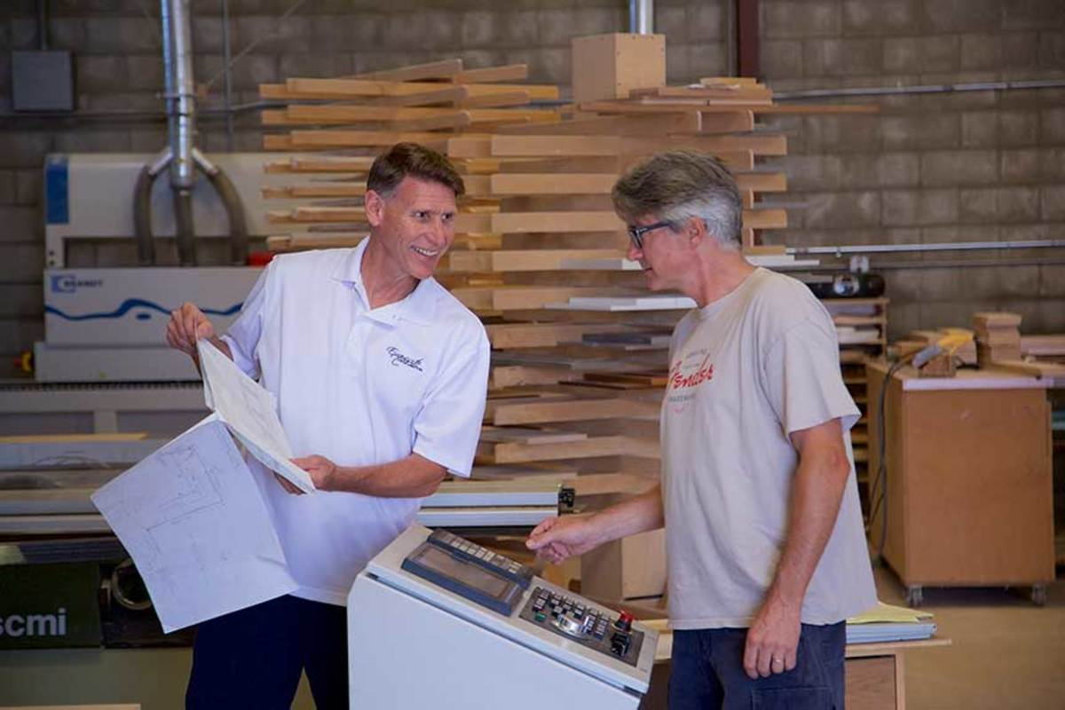 Jim Shuffler (white shirt) and members of his team at his shop in Portsmouth, Va.