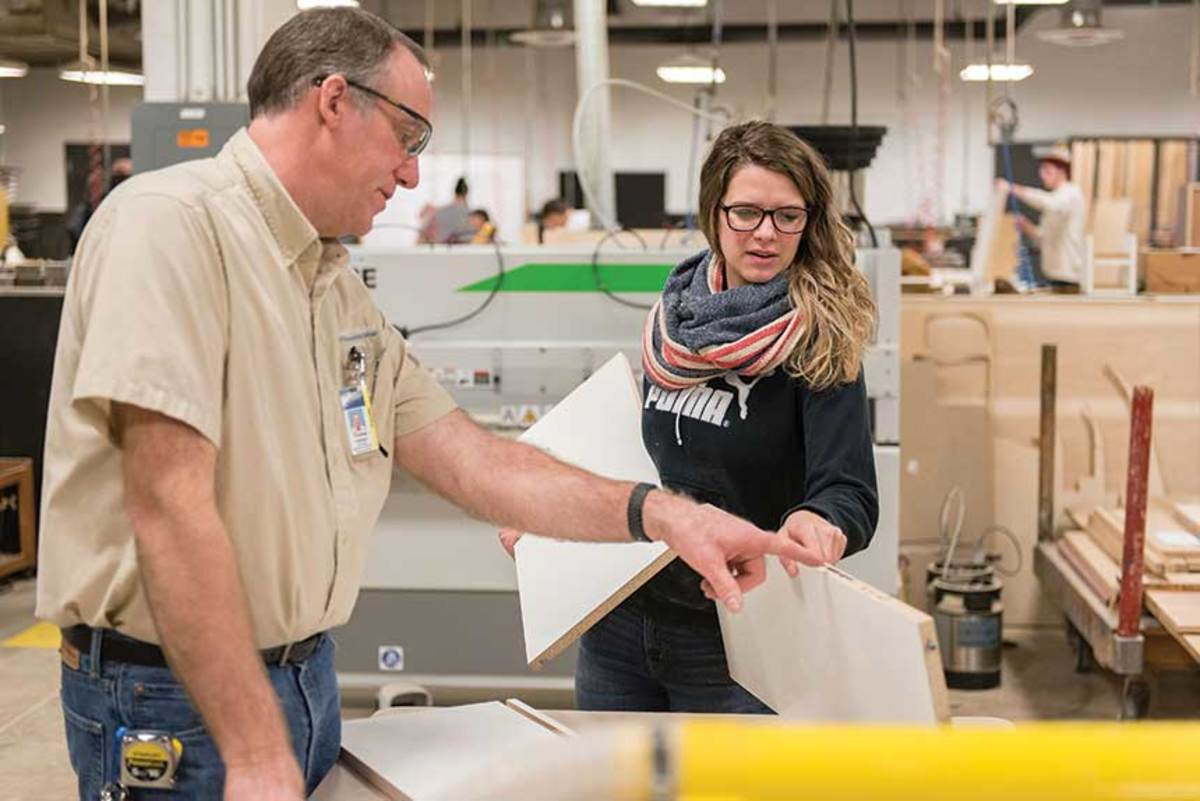 Thomas Hillstead (left) discusses edge quality with student Holly Soldner.