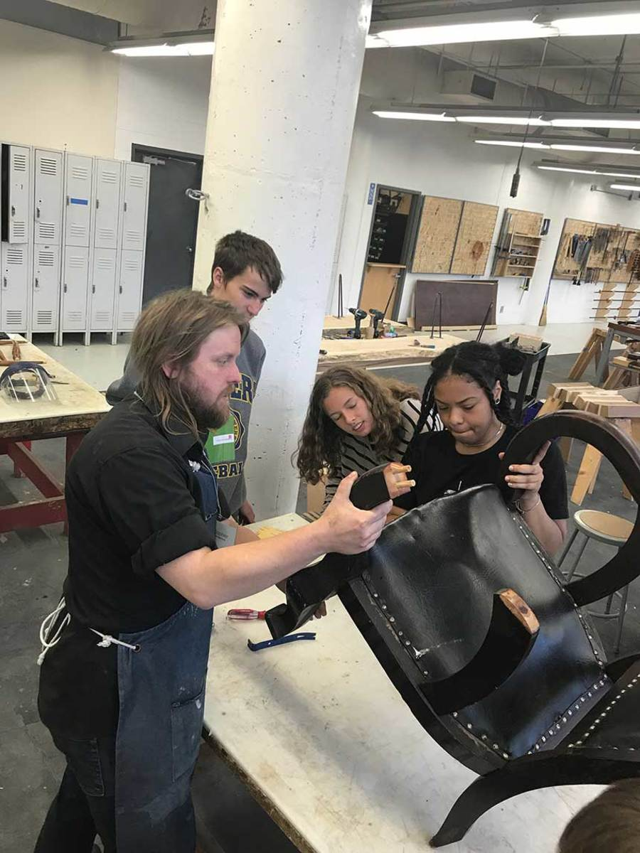 Students from the Milwaukee Art Museum's Teen Internship Program construct a chair during the conference's Craft for a Greater Good project.