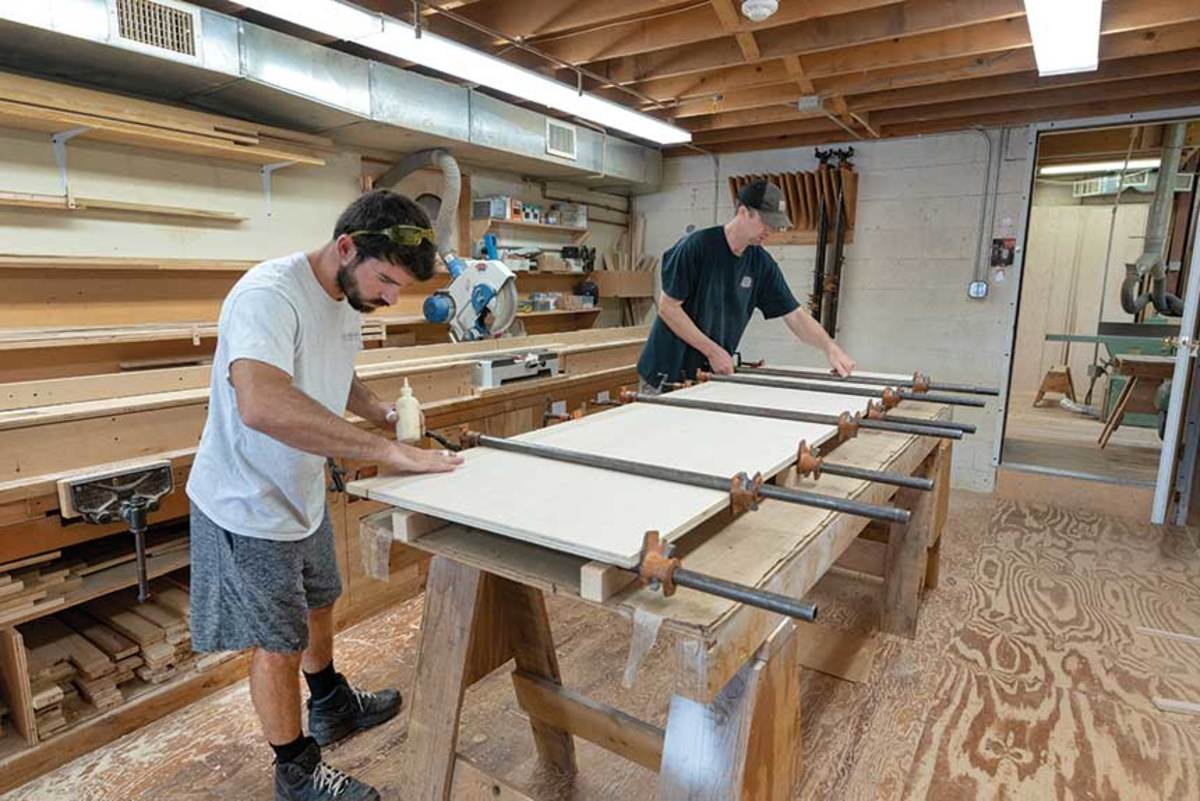 Adam Swist (left) and Jeremy Weinand assembling cabinets in the Newport, R.I. shop.