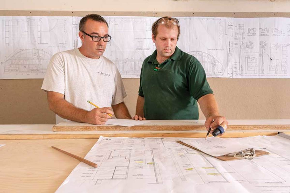 Shop foreman Mike Menard (left) and chief cabinet maker Karl Cressotti.