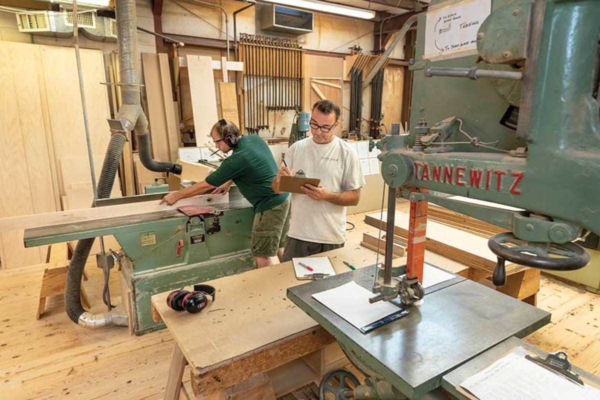 Cressotti (green shirt) uses the shop's Linmec long bed joiner.