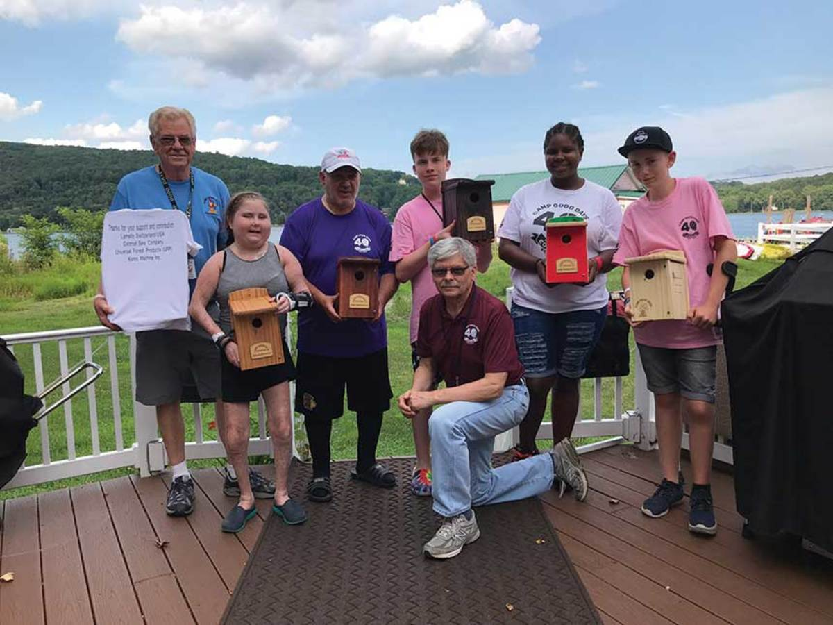 Campers putting together birdhouses and other projects using Lamello's connectors at Camp Good Days and Special Times in upstate New York.
