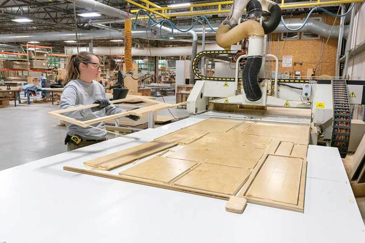 Production supervisor Jennifer Fredette pulls parts from the shop's SCMISigma 90 Plus beam saw.