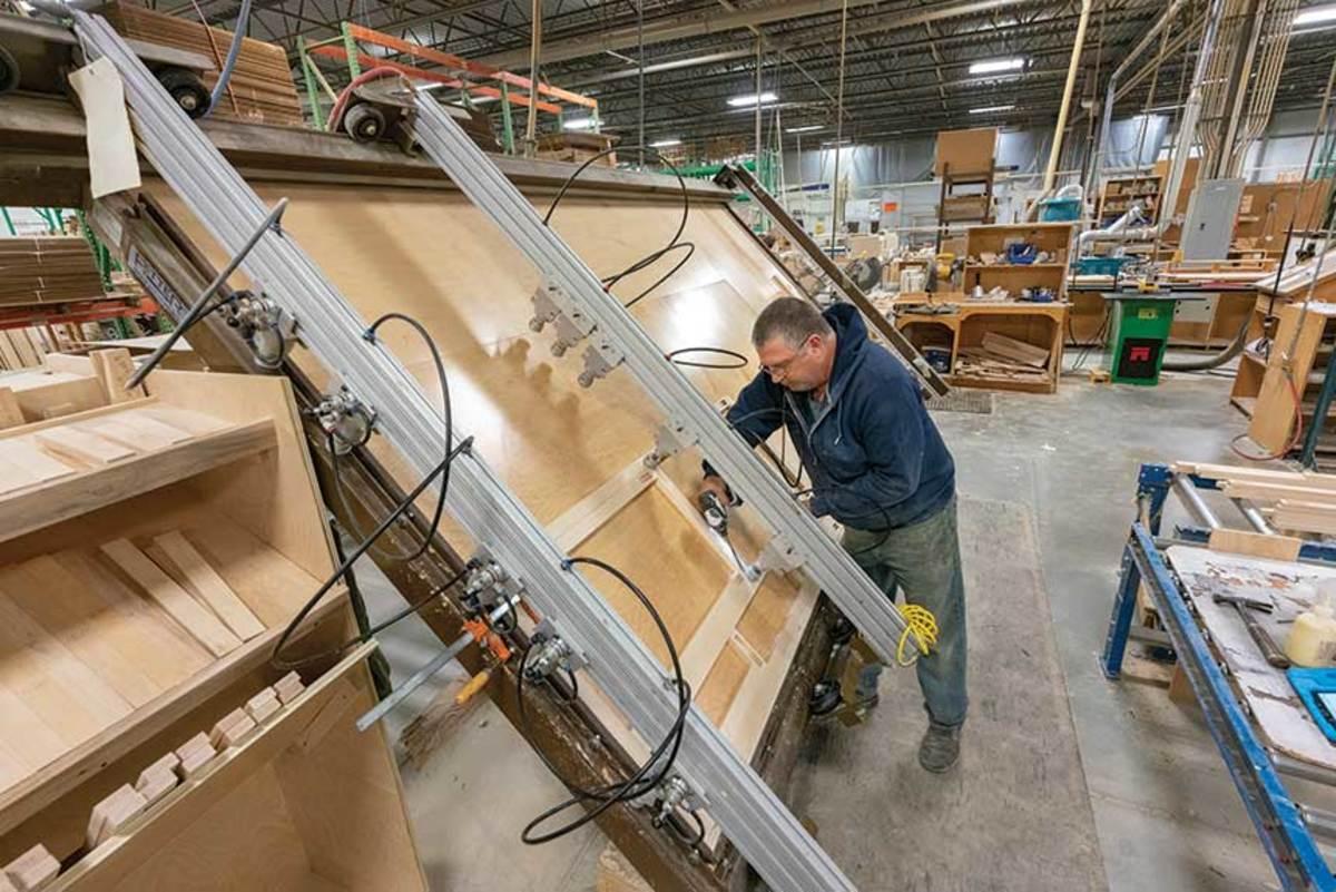 Dave Chagnon assembles frames.