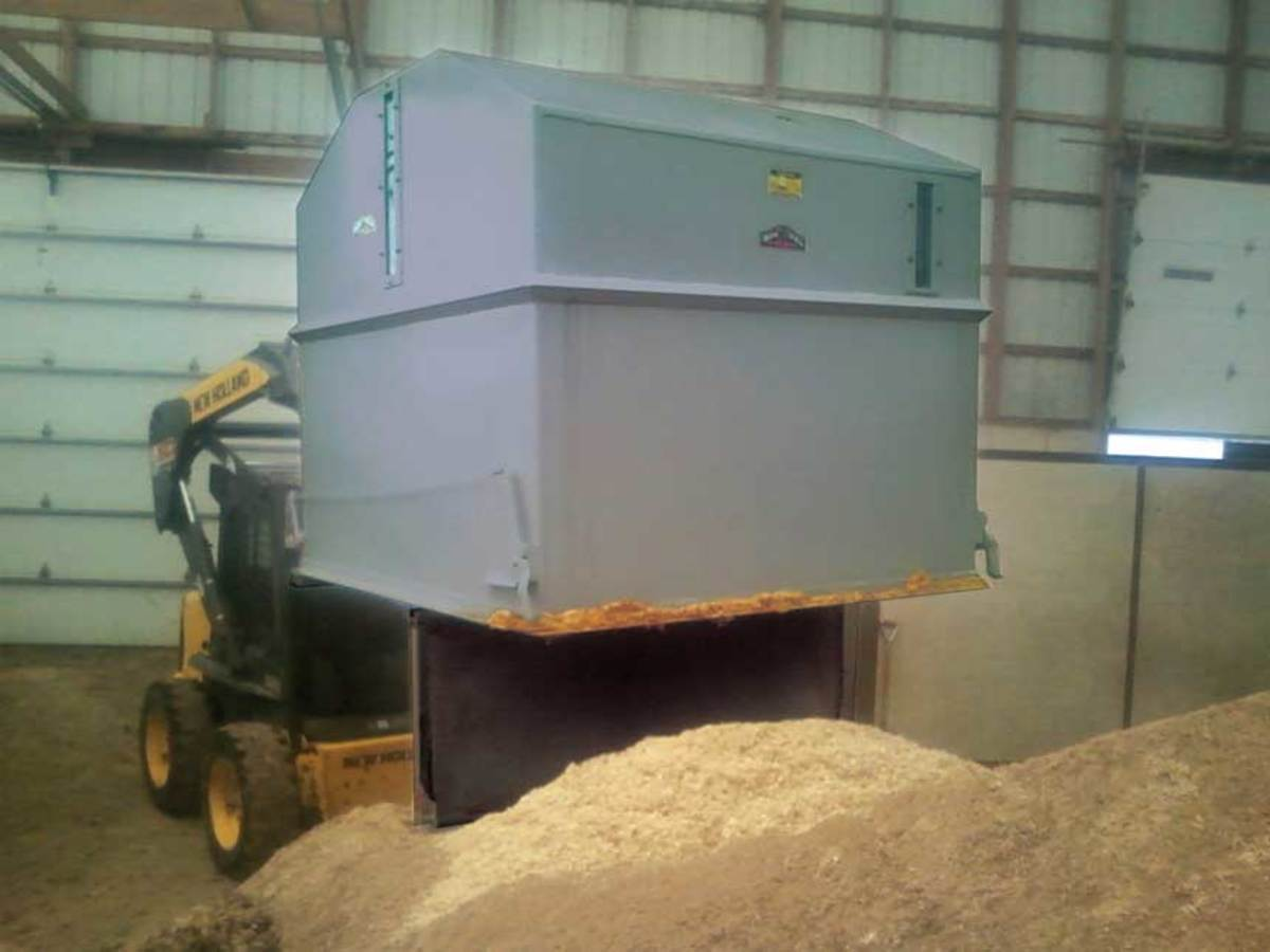 Iron Bull's Drop-Bottom Sawdust Hoppers attach to a shop's cyclone collector.