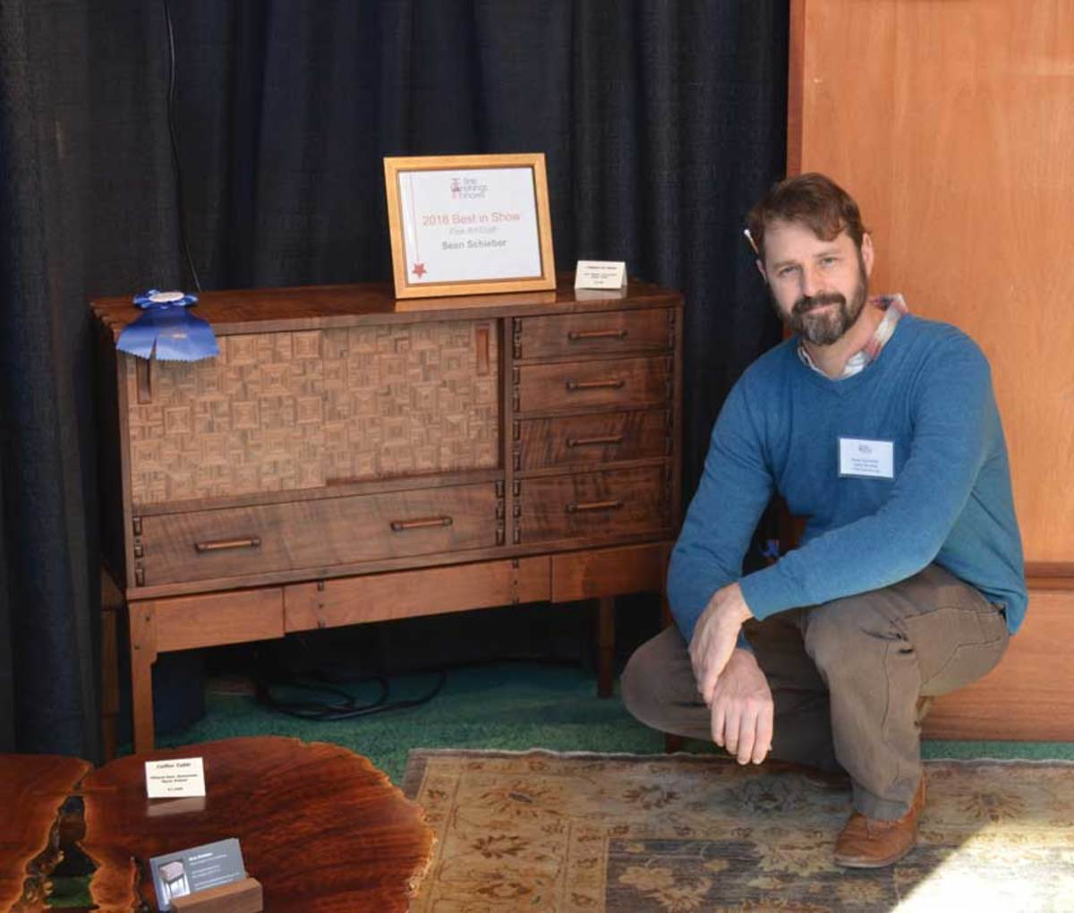 Sean Schieber, winner of Best Fine Art/Craft, and his walnut parquetry chest.