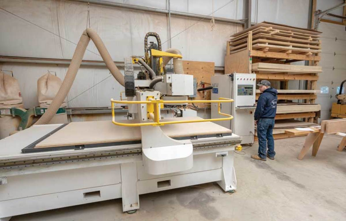 Brad Custance operates the shop's New CNC Smart ER Series II 3-axis machine with lathe attachment.