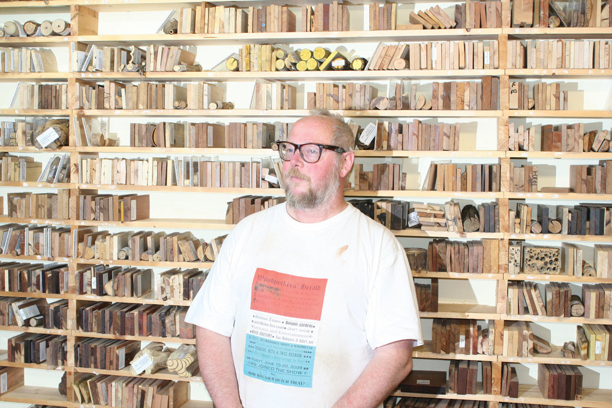 Member Willem Hurkmans in front of his impressive wood collection.