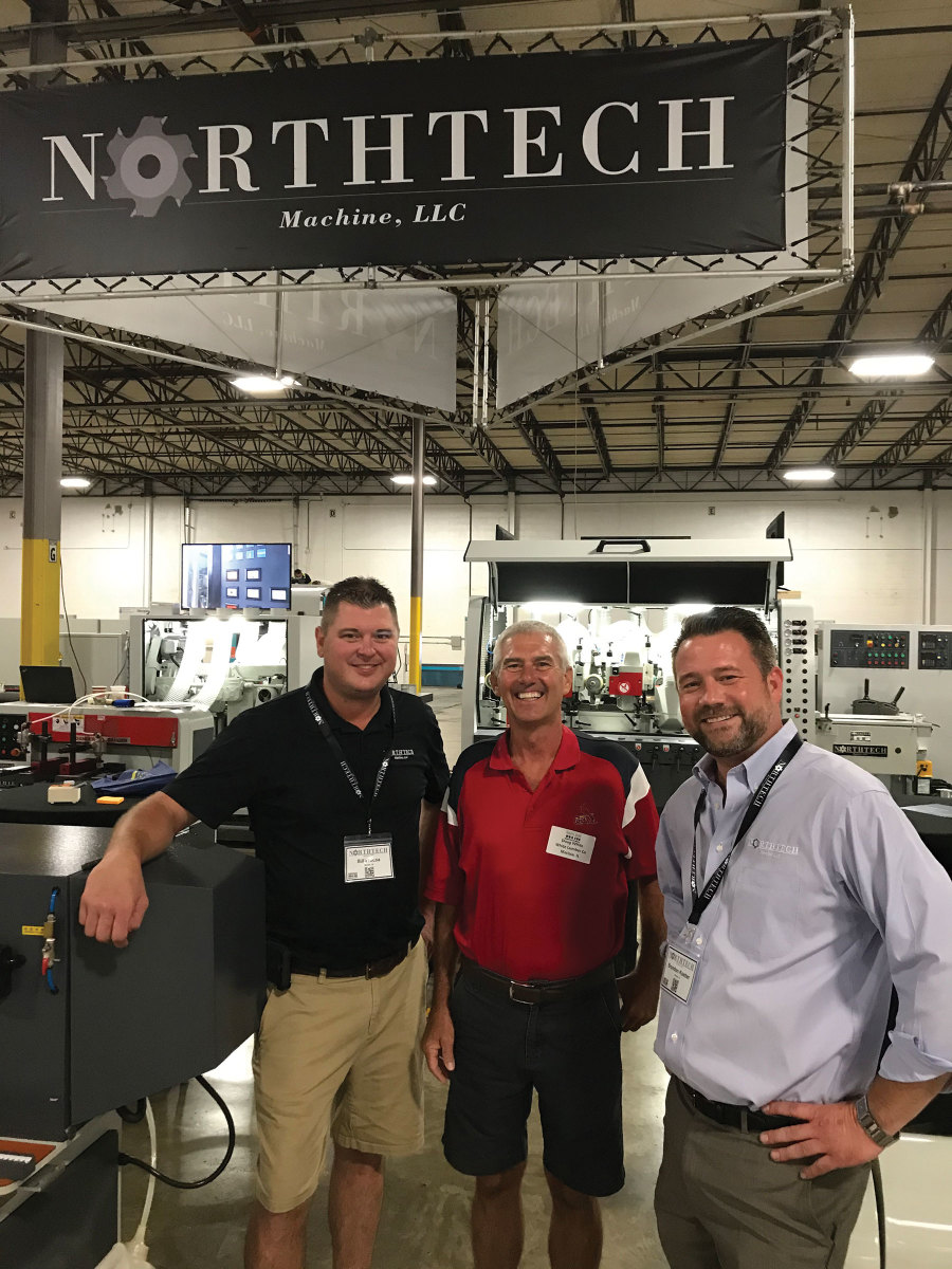 Bill Prousa (from left) with Doug White and Brandon Koetter at Northtech Machinery's booth and other scenes from the first Woodworking Fair Midwest.
